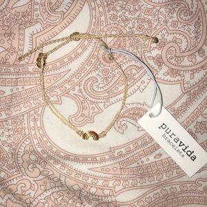 Tan braided Pura Vida rainbow charm bracelet